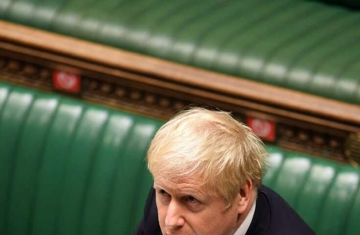Boris Johnson defended his belated decision to impose a second coronavirus lockdown—but the opposition derided a