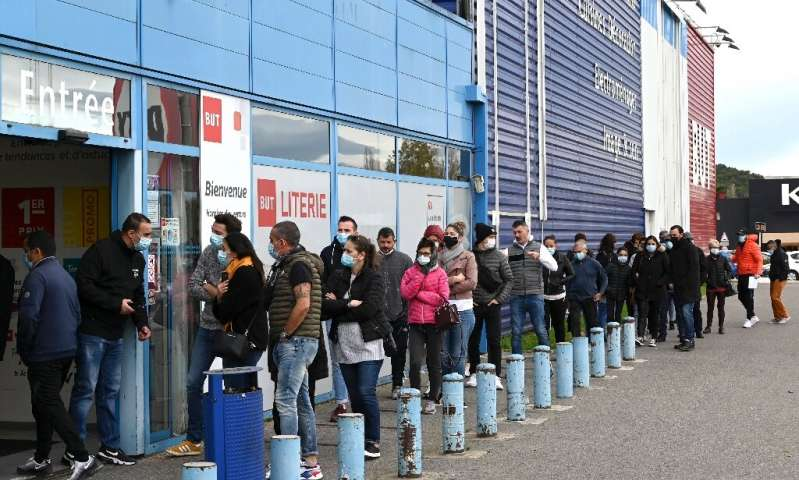 Customers queued outside a furniture store in southeastern France as shops were allowed to lift their shutters for the holiday s