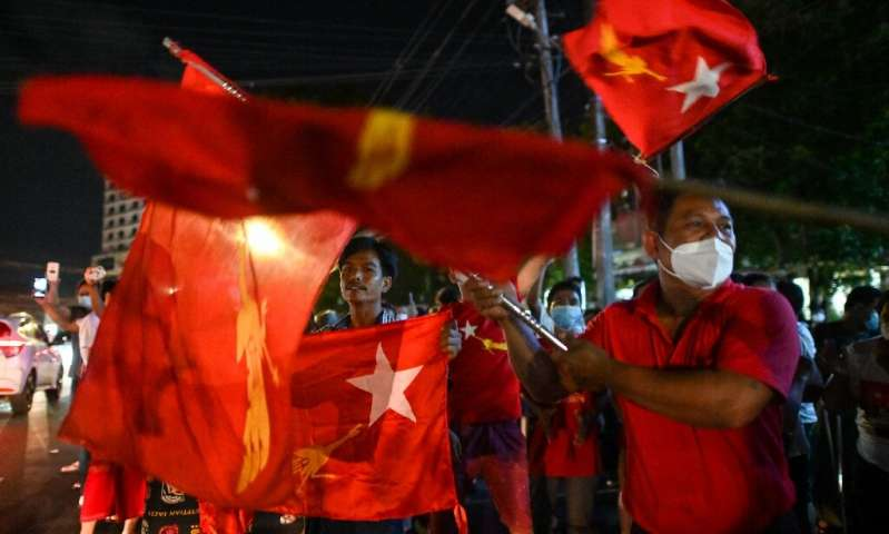 Hundreds of die-hard supporters ignored warnings and gathered in a premature celebration in Yangon