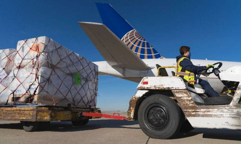 Pfizer vaccines from Belgium are unloaded at Chicago's O'Hare International Airport in early December