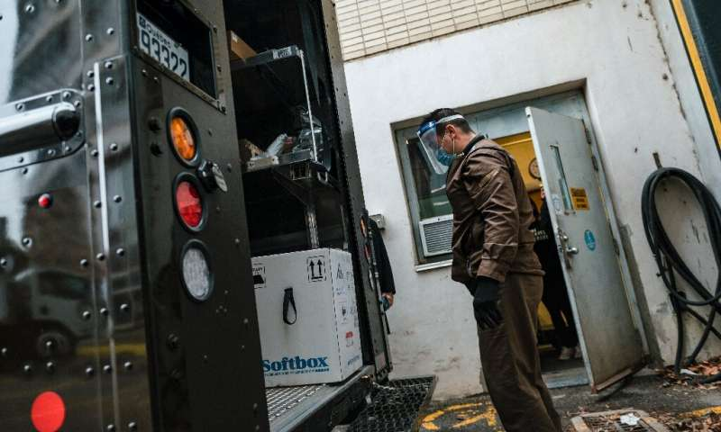 A UPS employee looks at a box with some of Canada's first Covid-19 vaccines in Montreal, Quebec on December 14, 2020