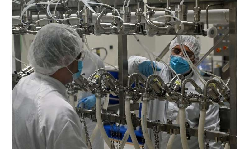 Biochemists work inside a buffer preparation room at Takeda Pharmaceuticals (Asia Pacific) in Singapore. The city-state's  coron