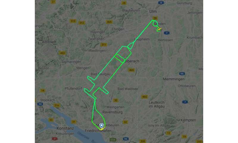 German pilot traces giant syringe in sky to mark Covid jabs