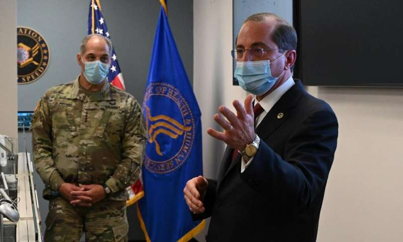 US Health and Human Services Secretary Alex Azar (R) and General Gus Perna visit the Operation Warp Speed Vaccine Operation Cent
