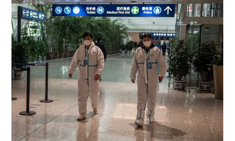 Health workers were waiting to meet the WHO team as they arrived in Wuhan on Thursday ahead of their probe into the origins of t