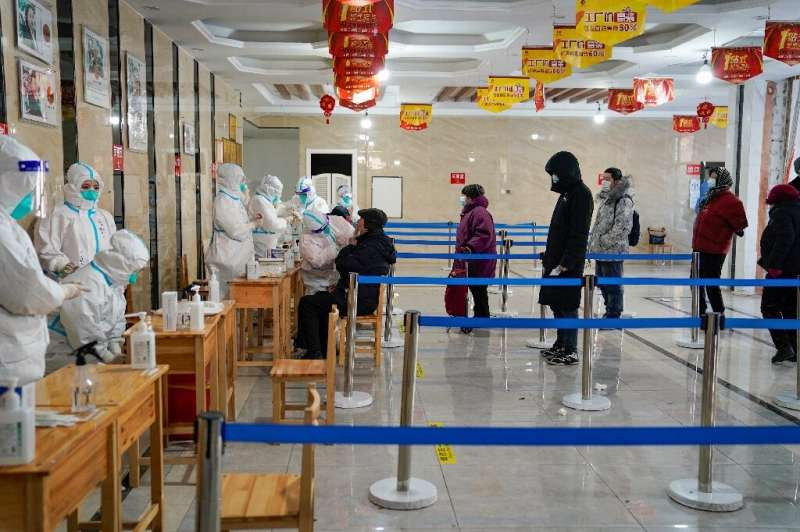Millions of people have been locked down again in China in a fight to control a fresh outbreak that has now claimed its first vi