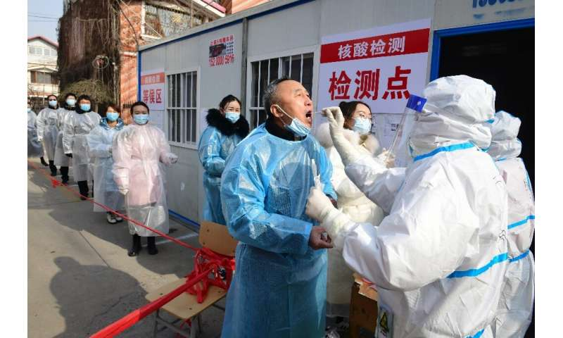 Residents of  Shijiazhuang in northern Hebei, China line up for Coronavirus tests
