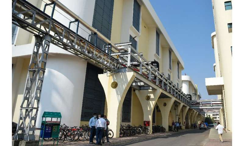 The palm-fringed Serum Institute campus in Pune is home to several buildings where vaccines are manufactured