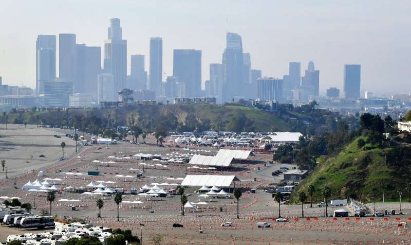 Vehicles make their way to a Covid-19 vaccination site at Dodger Stadium in Los Angeles, California on February 11, 2021, ahead